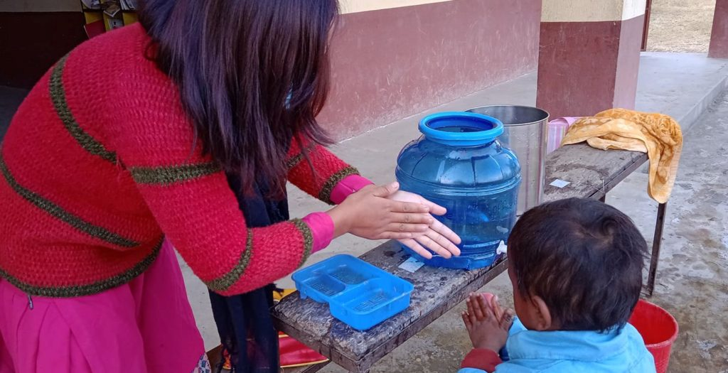 Susmita teaching hand washing, Taltuleshowry school