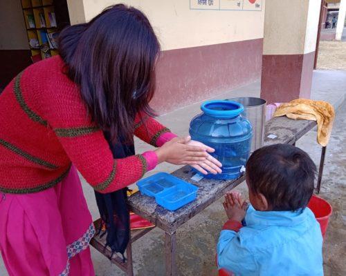 Susmita teaching hand washing, Taltuleshowry school