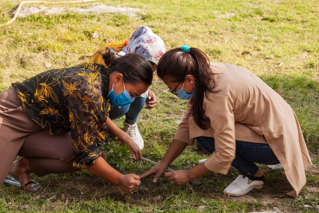 New Saathi's planting a flower to watch it grow as they develop their skills at spring training course
